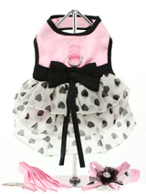 Pink Satin & Hearts Chiffon Harness Dress, Lead & Hat - ''Pure Elegance'' describes this, one of a kind, designer harness dress. Made from highest quality pink satin and three tiers of delicate white chiffon skirting printed with black hearts. As a finishing touch a beautiful black satin bow surrounds the waist. It has a sturdy reinforced D-Ring and a do...